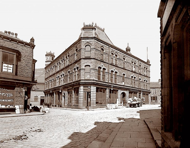 Also known as Co-op Buildings, the photo is taken from Albert Street. the White Horse Inn can be seen to the right of Carlton Buildings. The building just visiable on Crown Street was a foundary, it later became Sowden's blacksmith shop.