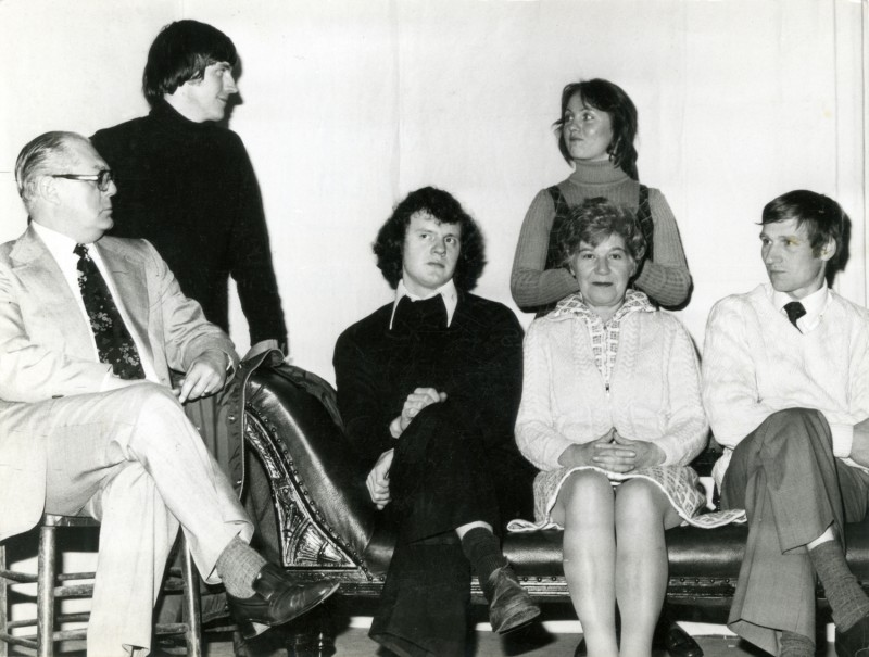 Press photo of Little Theatre cast of Black Comedy, 1976: Lloyd Greenwood, Chris Henwood, Graham Sunderland, Sharon Frazer, Nora Dodd (seated), and Steve Hirst